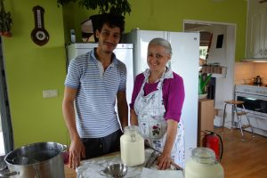 Abdul and Eerika smiling in the kitchen.