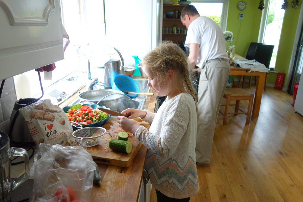 Preparing salad in the kitchen.