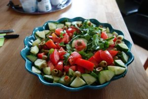 Tomato, cucumber, and olive salad.