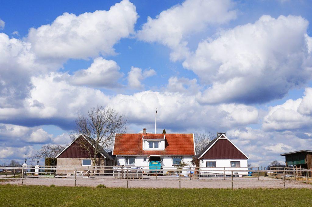 The farmhouse on a sunny day.